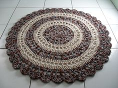 Free tutorial: http://craft.tutsplus.com/tutorials/crochet/crochet-an-amazing-mandala-floor-rug/