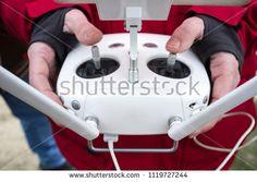 Pilot maneuver dron on remote controller. Moving left control stick for pitch