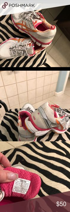 ASICS Dynamic Duomax Running Shoes - SZ 6.5 Pre-owned ASICS athletic shoes in excellent condition.  These dynamic duomax shoes are white with pink and orange detail.  Get your run on ladies!! Asics Shoes Athletic Shoes