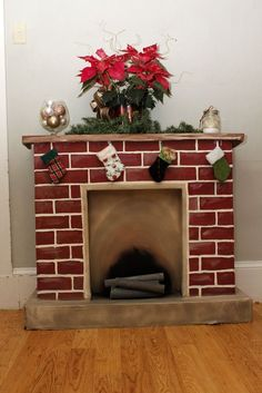 100 current and traditional ideas for your Christmas fireplace - Fresh ideas for the interior, decoration and landscape - red bricks christmas fireplace christmas decoration - Wooden Fireplace, Cardboard Fireplace, Fake Fireplace, Fireplace Mantels, Wooden Mantel, Fireplace Ideas, Fireplace Decorations, Fireplaces, Diy Christmas Decorations