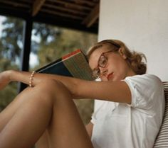 Grace Kelly pauses in her reading.    theniftyfifties:    Grace Kelly reads.