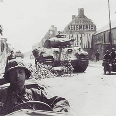 "Invasion front. On 9 June 1944 at the end of the morning attack on town Norrey had been defeated and the Panthers of the 3.Kp/12 SS-PzRgt ""Hitlerjugend"" had been withdrawn to Villeneuve, a hamlet of Rots. Here can be seen two of Panther tanks in position towards the west, facing the Canadians as well as light vehicles from the divisional escort company"