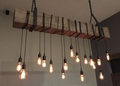 """Add a rustic, industrial feel to your home, restaurant, bar or wherever with a reclaimed barn beam light fixture. Beams are reclaimed from 100+ year old barns from the Midwest. Height and width of most beams are between 7-9"""". Not all beams are the same. Some may contain more or less"""