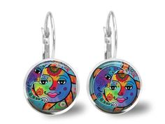 These fun glass tile earrings are made of vibrant and colorful celestial moon and sun laer printedimages that are adhered into silver plated earring trays with lever back earwires.  The cabochon glass tile covered images measure 18mm and the earrings measure a total of 1 1/8.  This is a made to order. It will take 3 days to make after the receipt of your payment.  Please do not wear the earrings into the shower as they are not waterproof  The earrings will arrive in an organza pouch.