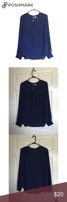 Navy triangle cut out blouse Bellatrix navy long sleeved blouse with triangle cut out/ keyhole. Faux pockets at chest. Pleat detail down center of top. Brand sold at Nordstrom. Bellatrix Tops Blouses