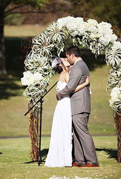 Ceremony arch made of air plants!   Brides.com