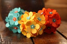 Paper punch flowers pinned to styrofoam balls.