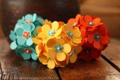 Paper punch flowers pinned to styrofoam balls.
