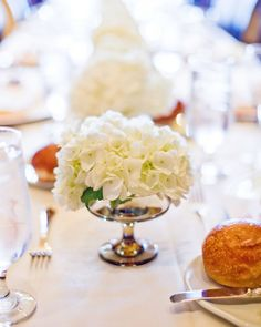 You can also line tables with glassware. Fill them with deconstructed plants (hydrangea, lilies and hibiscus work well) or grocery store blooms for a truly effortless table that feels thoughtful.