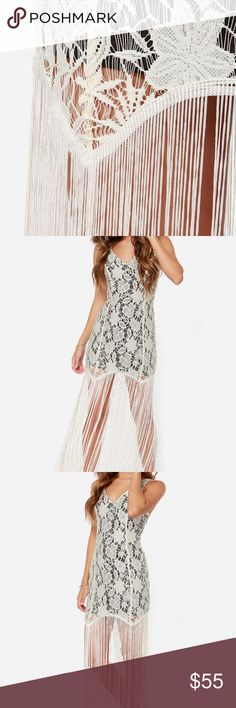 """LULUS Gimme Shimmy Cream Lace Fringe Dress Worn 1x, amazing dress. Channel the days of flappers and fancy parties! Cream lace starts with a sleeveless bodice and enticing V-neck front and back, then skims your curves down a sheath shape. The real showstopper is length of extra long cream fringe that shimmy from the hem down to a maxi-length. Hidden back zipper/hook clasp. Lined to mid thigh in black stretch knit. Model is 5'7"""" and is wearing a size small. Fringe measures 27"""" long.  Halloween…"""