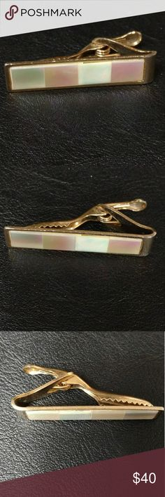 Vintage mother of pearl tie bar This vintage tie bar/ tie clip is made of mother of pearl squares on a gold tone setting.  This classic mid-century tie bar looks dapper on nearly any tie. Vintage Accessories Jewelry