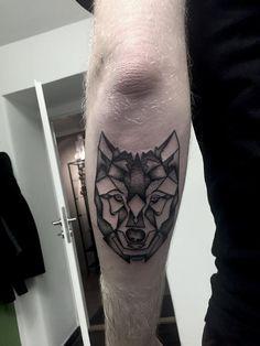 geometric head wolf dotwork tattoo