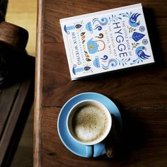 'The Little Book of Hygge' by Meik Wiking, a 'hyggelig' companion with my latte. More on the blog later.  #hygge #books #penguinbooks