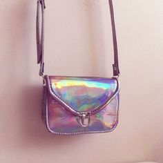 Finally got my very own holographic purse this weekend.  Not this one though.