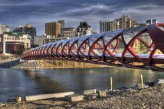 The new Peace Bridge, Calgary  Peace Bridge is a pedestrian bridge, designed by Spanish architect Santiago Calatrava, that accommodates both pedestrians and cyclists crossing the Bow River in Calgary, Alberta, Canada. The bridge opened for use on March 24, 2012.    This connection was designed to accommodate the increasing number of people commuting to and from work and those utilizing Calgary's pathways. The bridge is reportedly used by 6000 people a day and has ranked among the top 10.