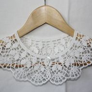 Hand crocheted collar in white. Made from cotton yarn. Size: approx. 15.5 in / 40 cm around the neck. Hand wash only.