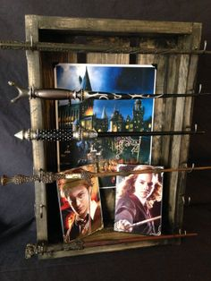 Harry Potter Wand Display Deluxe-Package. Holds up to six wands (sold separately), includes your favorite character photo and canvas poster....
