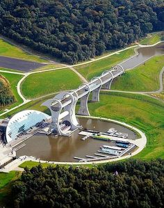 The Falkirk Wheel—As the centrepiece of The Millennium Link, the project to reconnect and regenerate the Forth & Clyde and Union canals, The Falkirk Wheel is hailed as a monument to the skills of modern engineering. Created to replace the flight of eleven locks that originally connected the two canals, the magnificent 115 ft Wheel is made of steel with two giant caissons each capable of carrying up to four boats at a time.