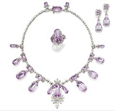 A suite of jewels, comprising a necklace, ring, and earrings, made from purple topaz and diamonds