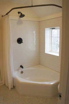 love the combo jetted tub and shower idea. Double curtains and bronzed bar make it perfect. Would love to have either a tile/beadboard surround or a little bit of ledge on one side for candles/soaps, etc.