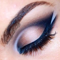 Use black eyeshadow and black eyeliner to create a thick line. Add a white accent to the crease of your eye and then through your line for a precise and illuminated double line look.