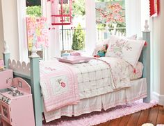 i love the light pink with the teal bed. and that bird cage is too cute!