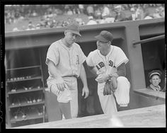 1946 - 1950 (approximate)  - Philadelphia Athletic Buddy Rosar and Boston Red Sox Ted Williams on dugout steps at Fenway Park.