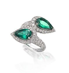 One-of-a-kind elegance, this ring from Picchiotti features a vibrant Zambian emerald complemented with diamonds, mounted in 18k white gold