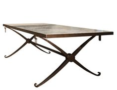 French 40's inspired dining table. Forged metal X base with bronze patina , stone or wood top available in custom sizes.  This table can also be made in coffee table size.