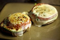 Ingredients: 1 sliced tomato 2 slices mozarella cheese 1 sliced tomato 2 sliced avocados 2 English Muffins Grated parmesan cheese Basil leaves Salt and pepper  Directions: These instructions makes 4 servings, so each muffin side is a single serving. Using a broiler, heat your muffins until golden brown.