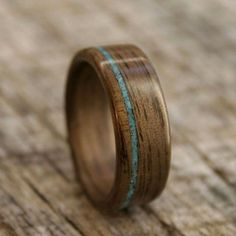 i think seth would like this. it also comes without the turquoise band in it and in various types of wood. #WeddingRing #Etsy - $195.00