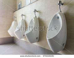Modern interior of rest room with men urinals