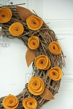 felt flower wreath. I think the textures would work well for a fall wreath, maybe in a couple of slightly different pumpkin-y tones?