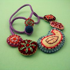 Embroidered Felt Necklace NO. 52  by Katrin Lerman, via Flickr  Another one for my daughter...the crazier the better :)