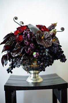 Dark and romantic florals set the tone as a dramatic entrance piece. #burtonandburton #frightfullyfun