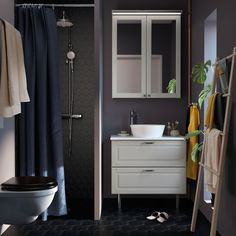 Pictures of small grey bathrooms a small dark grey bathroom with white cabinet and sink . pictures of small grey bathrooms Grey Bathrooms Designs, Small Grey Bathrooms, Ideal Bathrooms, Modern Bathroom, Small Rental Bathroom, Organize Bathroom Countertop, White Bathroom Cabinets, Bathroom Organization, Bathroom Drawers