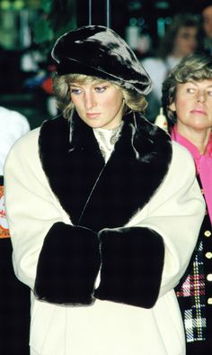 She was impossibly glamorous in a monochromatic coat with black fur trim paired with a matching beret during a shopping trip in Germany in 1987. (Photo by Georges DeKeerle/Getty Images)