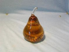 Asking:  $57/6.50   Amber pear tight controlled bubble pear from Erickson Glass in Bremen Ohio. This item is 5 inches tall and it has no chips,cracks or repairs