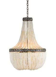 Hedy Chandelier from Currey & Company features strands of pyrite beads. Neutral color palette is accented with dark grays to create opulent lighting. a Marjorie Skouras design