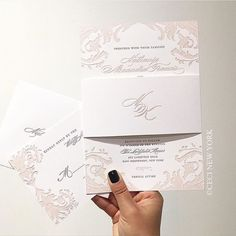 A custom baroque wedding invitation in a blush and grey design from Ceci New York.