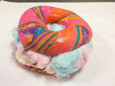 Rainbow Bagel Stuffed with Funfetti Cream Cheese and Cotton Candy from Brooklyn's The Bagel Store