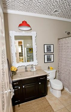This is where I got my inspiration for my bathroom.  Shower curtain, barn light, little yellow bird and all!