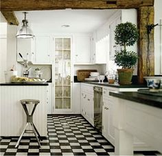 White kitchen with black and white floor
