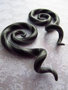 Black and Silver gauge earrings.