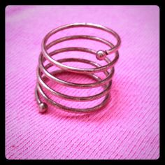 Silver Spiral Ring Edgy spiral ring in silver. Super cute! Very slightly tarnished on the inside. Size 5.5 Jewelry Rings