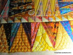 Want to remember this border curved cross hatching.  I've never seen it done this way before...ThreadTales Quiltworks