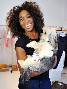 The 7-Time Slam tennis ace gets a congratulatory hug from Havanese Harold at Wednesday's New York Fashion Week presentation of her clothing line, EleVen.