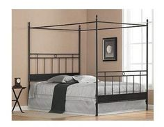 Transform your bedroom into the ultimate hideaway with this black metal queen-size canopy bed. This bed features multiple metal bars running along the headboard and foot-board and has four posts that form a canopy to create a resort look right at home. Headboards For Beds, King Size Canopy Bed, Bedroom Furniture, Bed, Metal Canopy, Black Canopy Beds, Bed Frame And Headboard, Headboard And Footboard, Bedroom Headboard