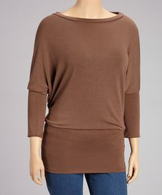 Take a moment to bask in casual comfort. This delightful tunic adds a layer of elegance and style that can't be beat.