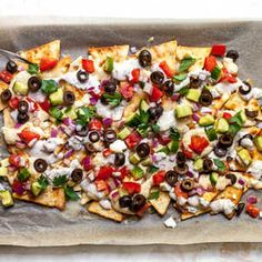 It's pretty hard to mess up anything with chips and cheese. That's why it only makes sense to put a Mediterranean spin on a classic sheet. Clean Eating Snacks, Healthy Snacks, Healthy Recipes, Greek Nachos, Mediterranean Diet Recipes, Mediterranean Dip, Mediterranean Appetizers, Recipe Finder, Cooking Light